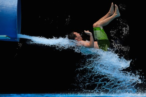 Mesmerizing High-Speed Photos Capture People Barreling out of a Water Slide