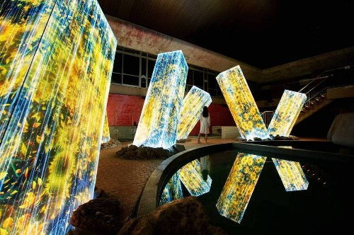 Immersive Nature Art Projections Emerge on Megaliths in a Bath House
