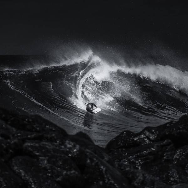 Dramatic Photos of Surfers Carving Waves in Hawaii
