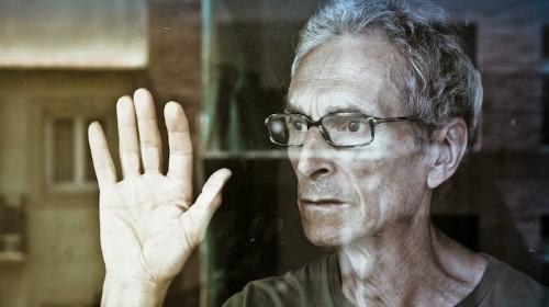 Elderly Man Holds On to Eternal Love Through Photographs