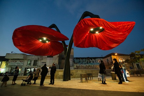 Giant Urban Flowers Bloom When Pedestrians Pass By Under Them