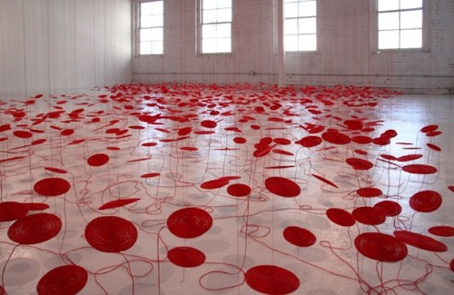 Hundreds of Hanging Red Coils Symbolize Human Connections
