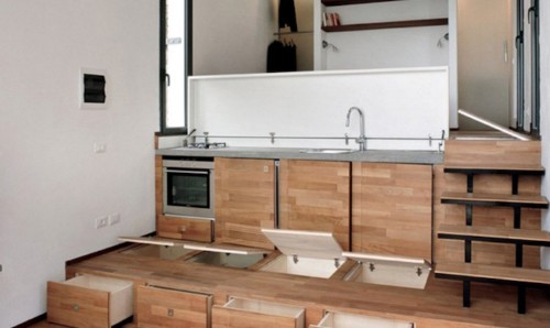 Tiny Home Cleverly Conceals a Full-Size Kitchen Beneath the Stairs