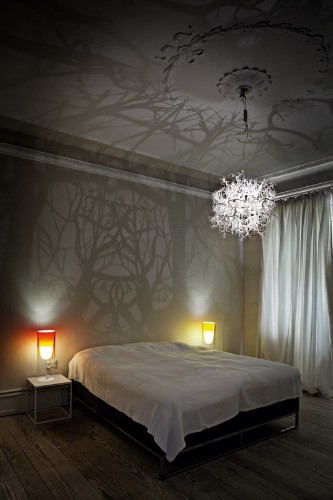 Chandelier Produces a Forest of Wild Tree Shadows