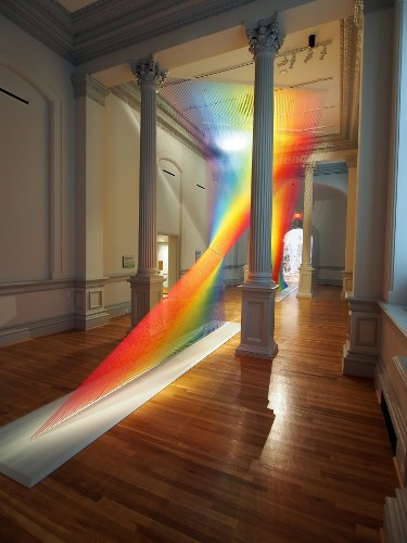Vibrant Rainbow Installation Made with 60 Miles of Thread Weaves through the Smithsonian