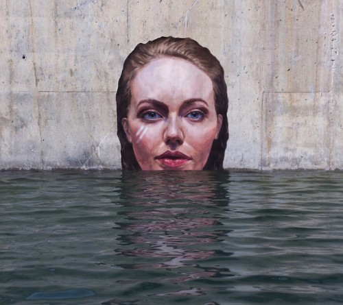 Artist Paints Stunning Murals of Women in Water All While On a Paddle Board