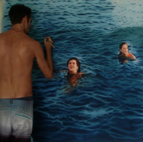 Artist Poses Playfully with Incredibly Lifelike Paintings of Swimmers