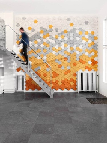 "Sound-Absorbing Wall Tiles Made From Colorful Hexagonal ""Wood Wool"""