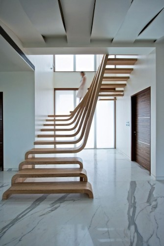 Beautifully Sloping Wooden Staircase Creates a Sense of Flow in the Home