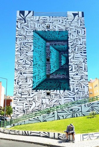 Optical Illusion Graffiti Creates Portal to a Parallel Universe on the Side of a Building
