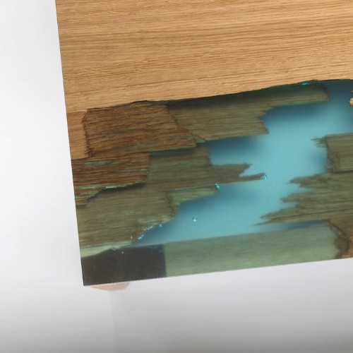 "Eco-Friendly Furniture Uses Glowing Bio Resin to ""Self Heal"" Salvaged Wood"