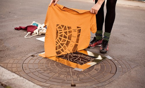 """Pirate Printers"" Are Using Manhole Covers to Print Urban Designs Directly onto Shirts and Totes"