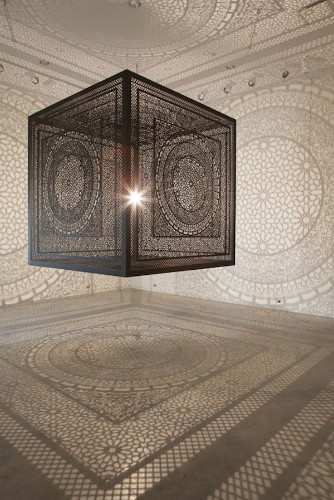 Intricate Shadows Formed with Single Light Bulb Inside Laced Cube