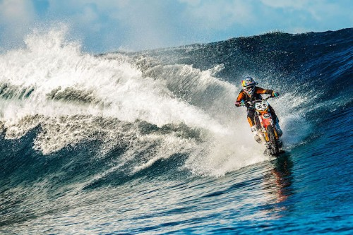 Stunt Rider Uses His Dirt Bike To Surf a Wave in Tahiti