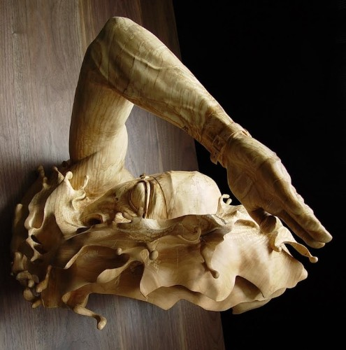 Stunning Swimming Sculpture is Carved From a Single Piece of Wood