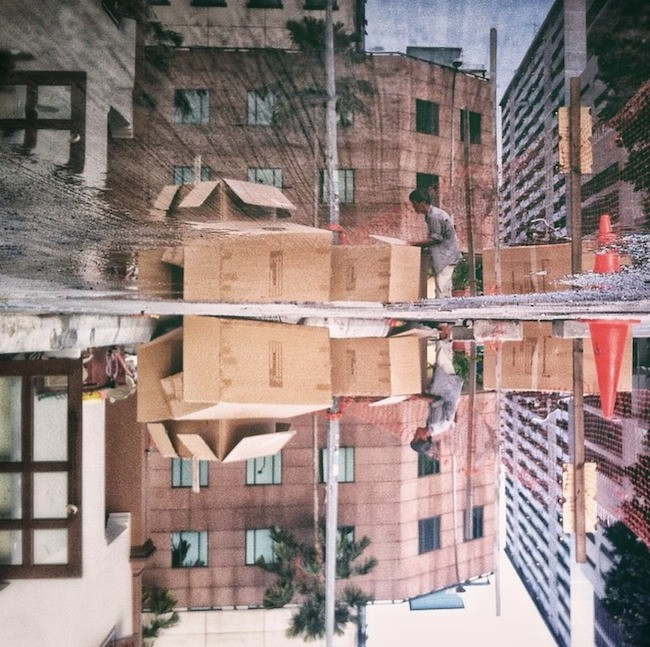 Creative Snapshots Reveal Singapore's Urban Landscape Reflected in Puddles