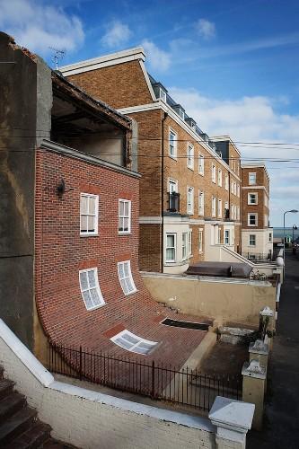 English Building's Brick Facade Playfully Slumps Down
