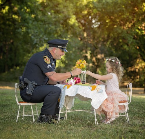 Police Officer Shares a Heartwarming Tea Party with the Little Girl He Saved