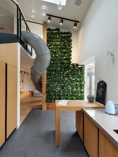 Apartment Owners Install a Winding Slide to Bring the Playground Indoors