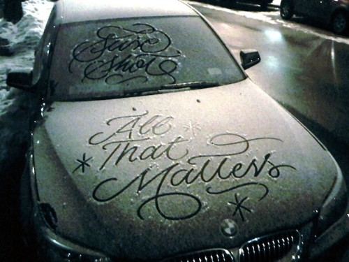 Graffiti Artist Creates Elegant Calligraphy Messages on Snowy Parked Cars in NYC