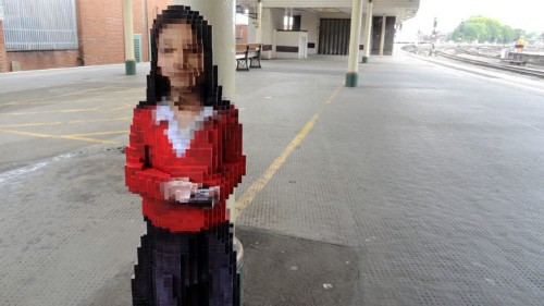 Pixelated Sculpture of a Girl Installed at a Train Station