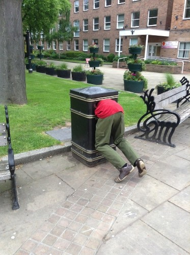 Public Sculptures Look Like People Stuck in Trash Bins