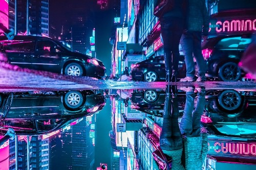 "Rain-Slicked City Streets Capture ""The Upside Down"" in Puddle Reflections"