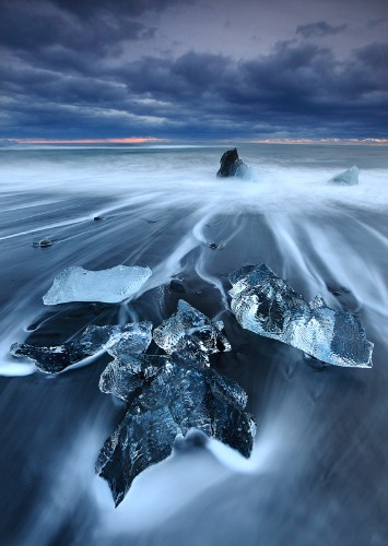 Turquoise Icebergs Dot Iceland's Black Sand Beach