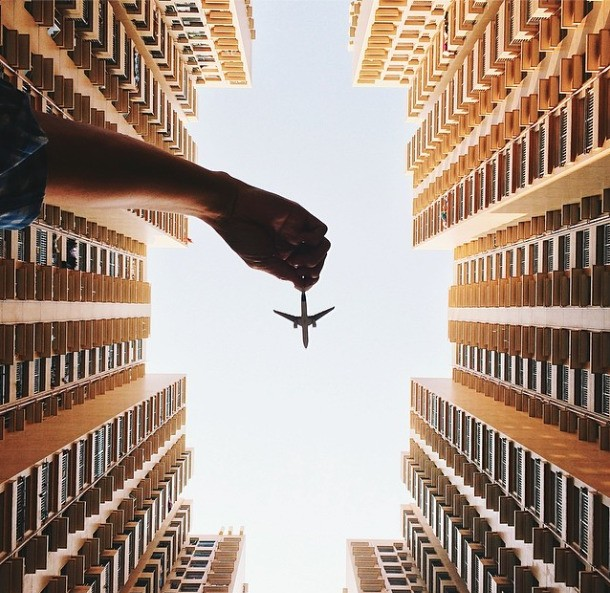 Fun and Imaginative Photos of a Toy Plane Soaring in the Sky