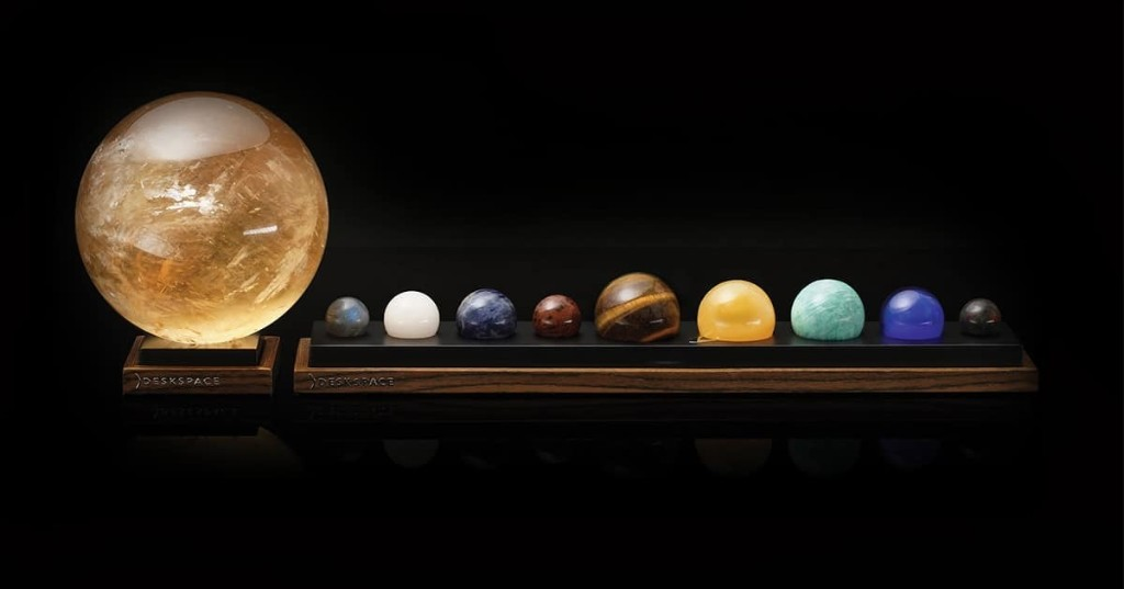 Hold the Planets (and Sun) in Your Hand With This Dazzling Solar System Desk Accessory