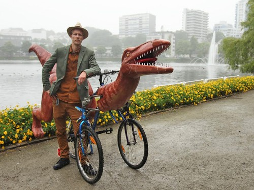 Artist Rides Handcrafted Three-Wheel Dinosaur Bicycle Across Norway