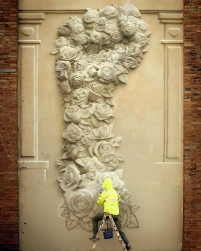 Street Artist Paints Beautiful Fist Made of Flowers to Symbolize the Power of Peace
