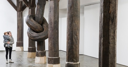 Art Installation Defies Expectations With 450-Year-Old Wood Column Tied Into a Knot