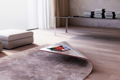 Upturned Corner of a Rug Reveals a Coffee Table Underneath