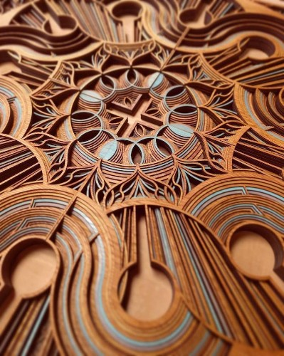 New Laser-Cut Wood Sculptures Embedded with Intricate Swirling Designs