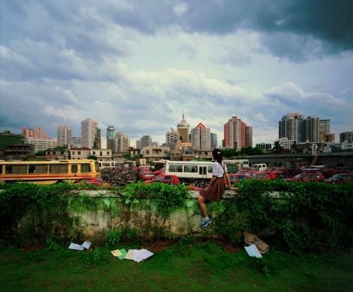 Faceless Young Girls Gaze Upon Developing Urban Skylines