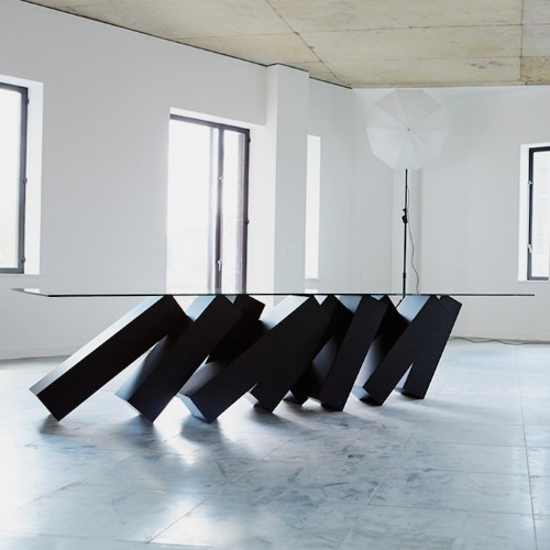 Mind-Bending Coffee Table Looks like It's Supported by Falling Dominos