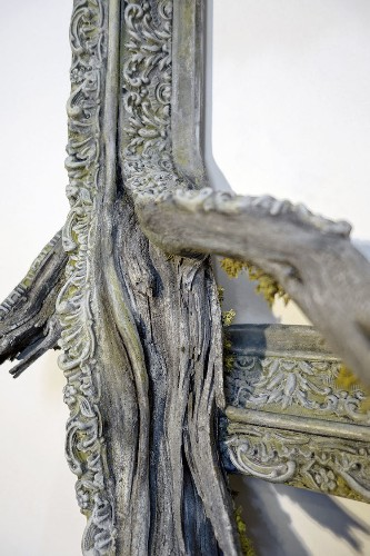 Reclaimed Gnarled Wood Branches Seamlessly Flow from Ornate Picture Frames