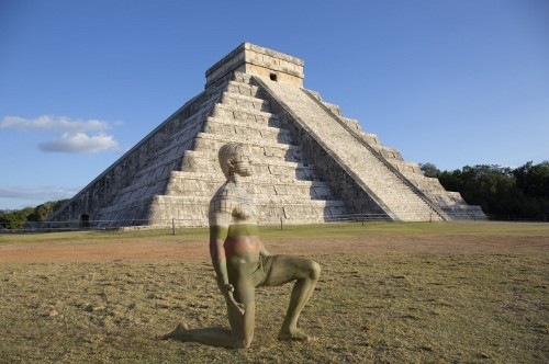Elaborately Bodypainted Live Figures Blend into the Seven Wonders of the World
