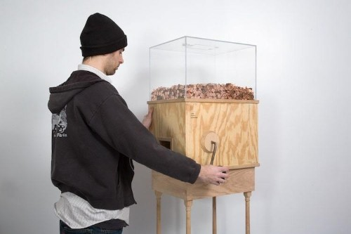 Artist Designs Machine You Crank to Earn Minimum Wage, One Penny at a Time