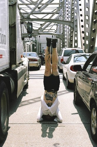 Man Travels Around the World to Take Headstand Self-Portraits