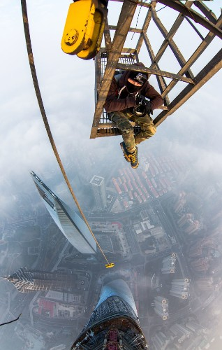 Rooftoppers Secretly Climb 650-Meter-High Crane in Shanghai