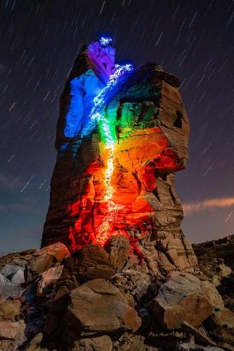 Long Exposure Photos Turn Man's Epic Rock Climbs into Rainbow Trails