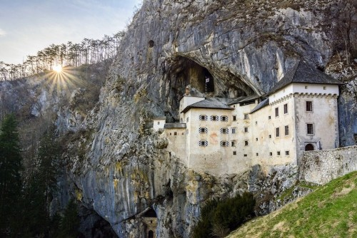Discover the Intriguing History of an Unusual Castle Built into the Side of a Cave