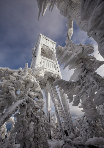 Breathtaking Photos Reveal Sculptural Ice on a Mountain in Slovenia