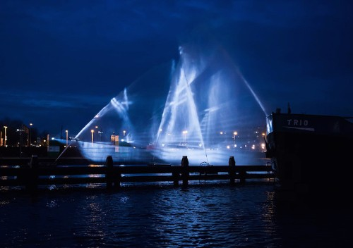 Ghostly 3D Ship Projected onto Vertical Sheets of Water