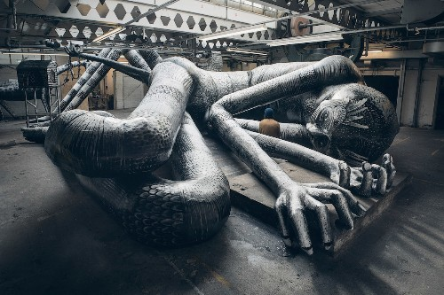 """Street Artist Transforms Abandoned Factory into a """"Mausoleum of Giants"""""""