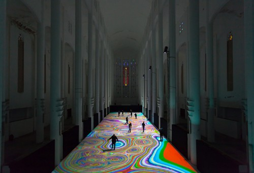 Magical Light Show Produces Carpets Along a Church Floor