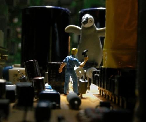 Tiny Figurines Explore Inside Electronic Machines