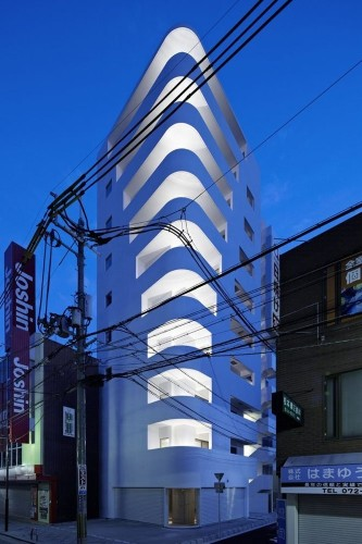 Japan's Minimal Apartment Tower Resembles a White Ship